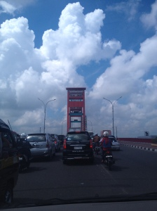 The view of Ampera Bridge from inside the car
